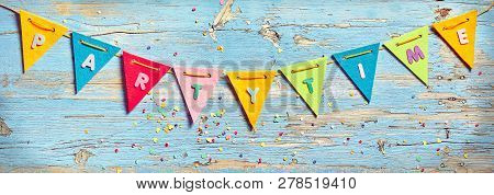 Party Time Bunting On Wooden Background
