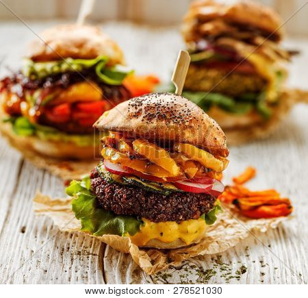Veggie Burgers, Homemade Vegan Burger With Fresh And Grilled Vegetables And Aromatic Curry Sauce On