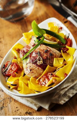 Italian Pasta With Pork Fillets Wrapped In Ham
