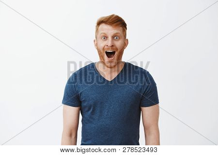 Wow, Incredible. Portrait Of Charmed And Thrilled Handsome Happy Redhead Boyfriend With Bristle, Dro