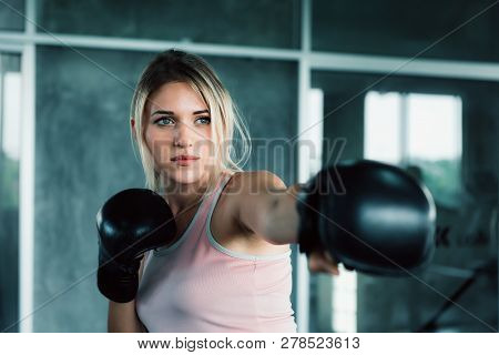 Female Boxer Is Training Punching In Fitness Gym.,portrait Of Boxing Woman Is Practicing Footwork In