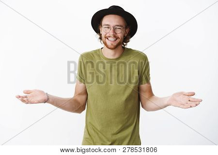 Who Cares Just Chill. Studio Shot Of Unbothered And Relaxed Handsome Party Hipster Guy With Beard In