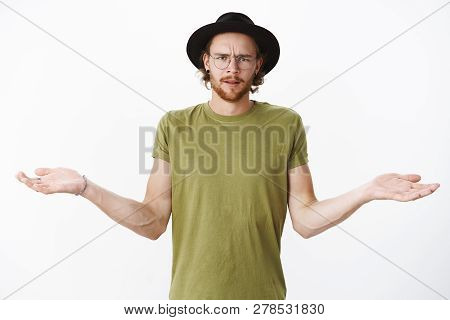 Cmon What Wrong. Portrait Of Pissed, Angry And Confused Bearded Guy In Glasses And Hat Frowning Disp