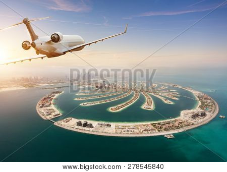 Private jet plane flying above Dubai city. Modern and fastest mode of transportation, business life and luxury style of life