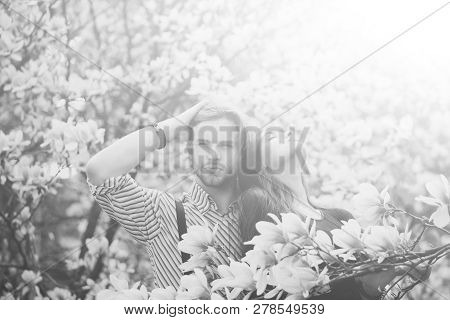 Man And Pretty Girl Or Cute Woman Enjoying Pink, Magnolia Flower Blossom On Trees In Flowering, Spri