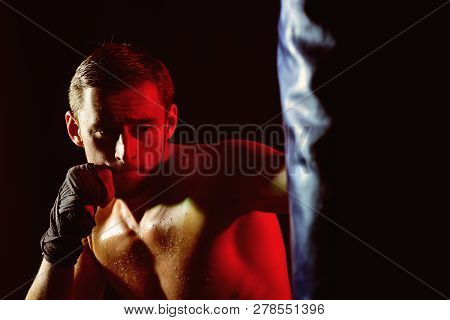 Training Concept. Man Boxer Training In Gym. Sportsman Punch Training Bag. Training Hard Or Go Home.