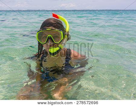 Beach Vacation Fun Woman Wearing A Snorkel Scuba Mask Making A Goofy Face While Swimming In Ocean Wa