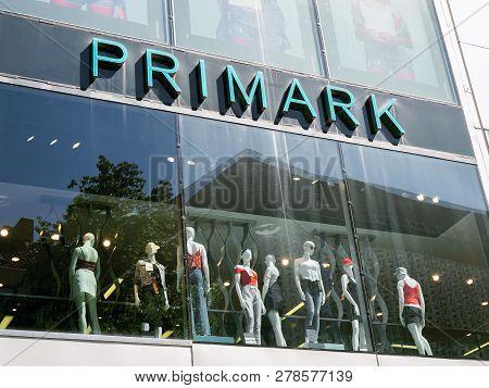 Hannover, Germany - May 7, 2018: Primark Logo Sign On Storefront Above Shop Window Mannequins Presen