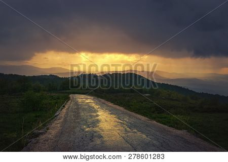 Sunset In Mountain Landscape. Lonely Road In Mountain Nature. Nature. Road. Natural Environment. Mou