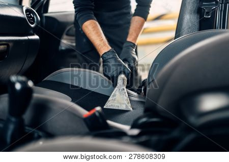 Dry cleaning of car interior with vacuum cleaner