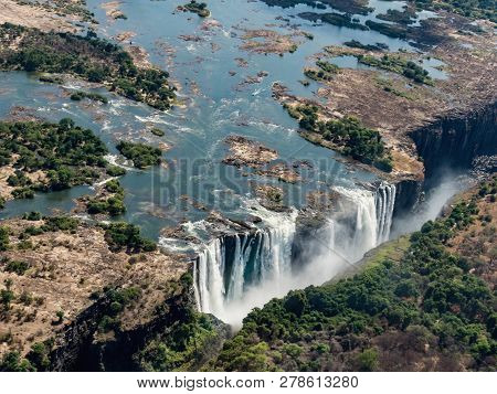Awesome Aerial View Of Victorian Waterfalls. View From Helicopter. Victoria Falls Is A Waterfall In