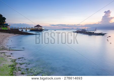 Sunset View Of The Moalboal Beach Famous Diving And Snorkeling Spot In Cebu, Philippines