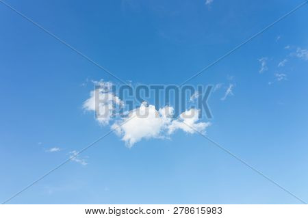 The Sky Is Bright Blue. There Are Clouds Floating Through. Feel Relax When Looking. See The Sun On T