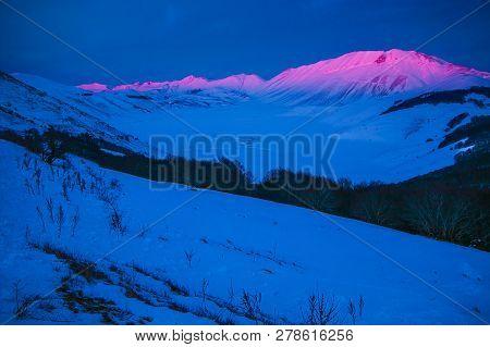 Wonderful View Of Castelluccio Di Norcia And Vettore Mountain At Dusk In The Monti Sibillini Nationa