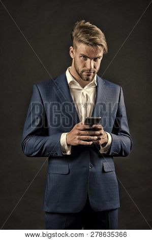 Digital Marketing And New Technology. Manager With Beard On Serious Face Hold Phone. Businessman Or