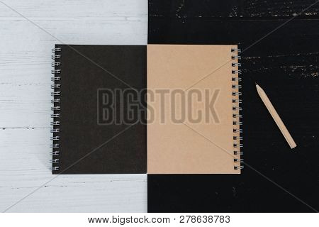 Black And Sand Sprial Notebooks On Black And White Surface, Contrasty Minimalist Flatlay