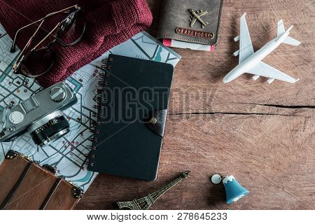 Retro Camera With Toy Plane And Travel Dairy On Old Wooden Background With Copy Space, Travel Concep