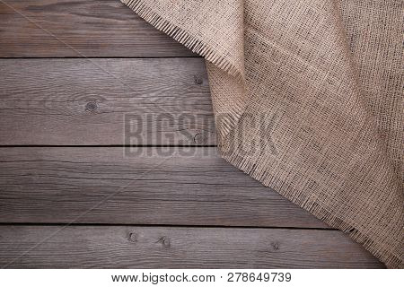 Natural Sackcloth On Grey Wooden Background. Canvas On Grey Wooden Table
