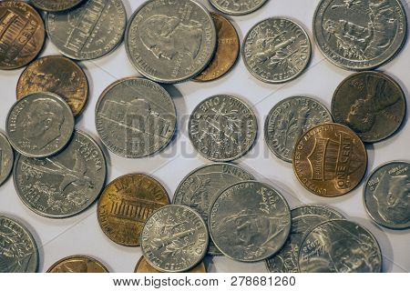 Close-up Of Quarters, Dimes, Nickels And Pennies.