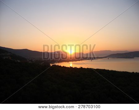 Harmonious View Of Colorful Dawning At The Adriatic Coast With The Sun Reflected In The Sea.