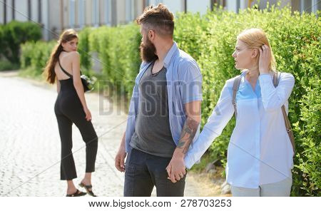 He Is A Cheater. Man Cheating His Wife Or Girlfriend. Love Triangle And Threesome. Bearded Man Looki