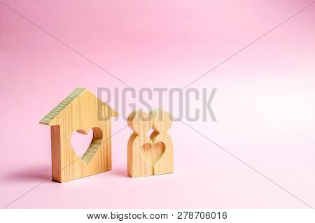 Pair Of Lovers Stand Near People At Home With A Heart. Happy Family Near The New Home. The Concept O