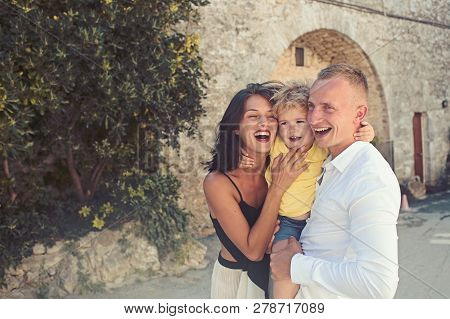 Love And Trust As Family Values. Mother And Father With Son Outdoor. Summer Vacation Of Happy Family