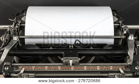 Vintage typewriter header with blank sheet of white paper retro technology top view