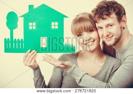 Ecology In Practical Domestic Life. People Real Estate And House Concept. Young Couple With Green Ec
