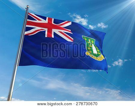 British Virgin Islands National Flag Waving On Pole Against Sunny Blue Sky Background. High Definiti