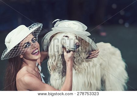 Happy Woman And Dog In Retro Hats. Sensual Woman Smile To Funny Pet. Fashion Girl And Domestic Anima