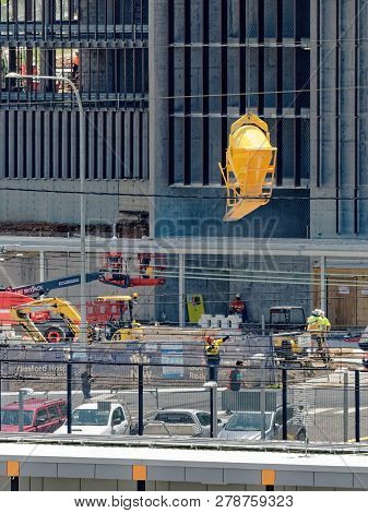 Gosford, New South Wales, Australia - December 20, 2018: Transporting A Concrete Bucket On The Build