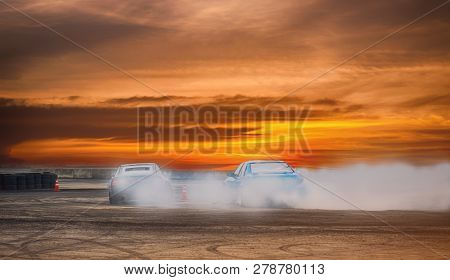 Car Drifting, Blurred Of Image Diffusion Race Drift Car With Lots Of Smoke From Burning Tires On Spe