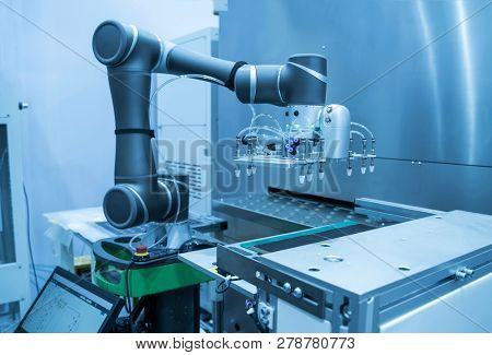 Automation of machine assembly of computer circuit board with robot arm,Smart factory industry 4.0 concept.