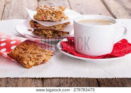 Flapjacks And Cup Of Coffee. Homemade Healthy Oat Bars With Honey And Currant. Flapjacks And Cup Of