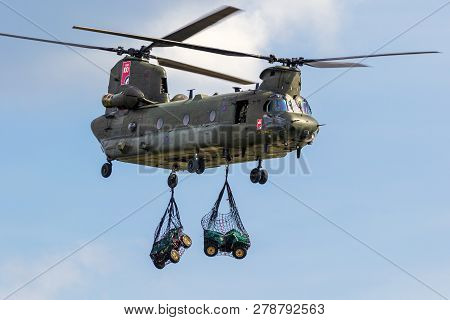 Berlin - Apr 27, 2018: British Royal Air Force Boeing Ch-47 Chinook Transport Helicopter Slingload D