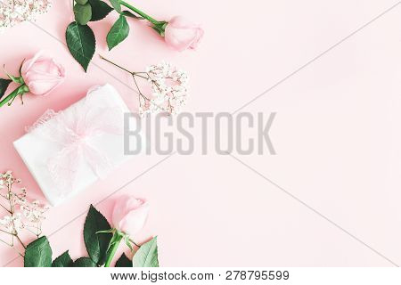 Valentine's Day Composition. Pink Rose Flowers, Gift Box On Pastel Pink Background. Valentines Day,