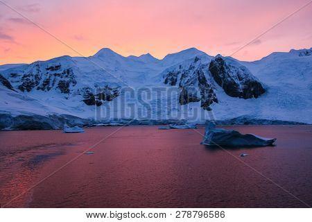 Antarctic Sunsets In Antarctica. Landscape Antarctica View Near The Ocean.