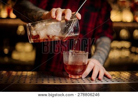 Bartender Pouring A Delicious Vieux Carre Cocktail From The Measuring Cup