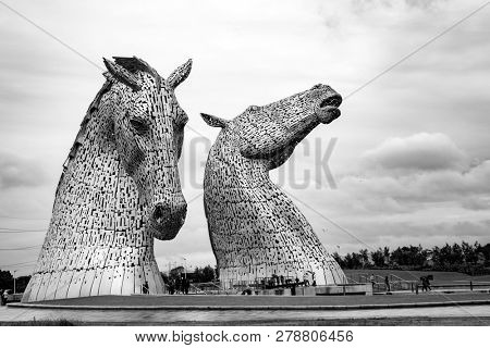 Falkirk, Scotland - 27 July 2015: The Kelpies, Helix Park, Scotland by sculptor Andy Scott. At  30 metres high, these are  the biggest equine statues in the world. Black and white.