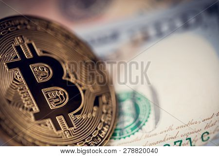 Hundred Us Dollars Banknote With Bitcoin Over It