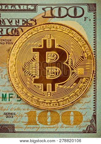 Hundred Usa Dollars With Golden Bitcoin Over It