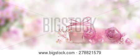 Soft Pink Still Life With A Smal Gift For Mothers Day