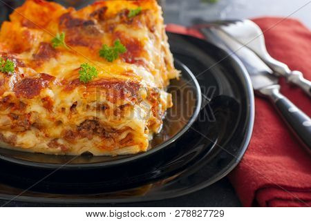 Traditional Italian Lasagna Bolognese With Minced Meat And Tomato Sauce, Horizontal