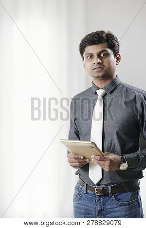 Ceo Of It Company With Digital Tablet In Hands