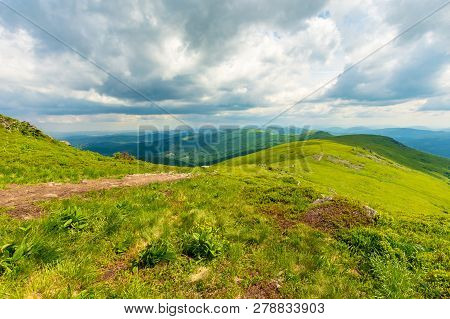 Path Through Mountain Ridge. Grassy Meadow And Cloudy Sky. Beautiful Summer Weather