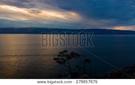 Evening View With Cape Burkhan At The Olkhon Island On Baikal Lake Or Small Sea, Siberia. Summer Hol