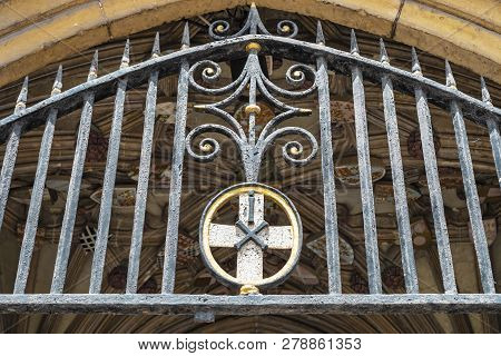 Canterbury, England - June 24, 2018: Close Up View Of The Entrance Gate And Coats Of Arms Of The Cat