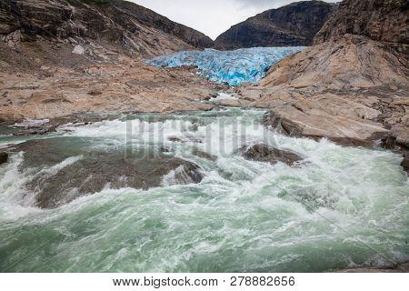 Nigardsbreen Glacier river and terminal face, Jostedalsbreen National Park, Sogn og Fjordane, Norway, Scandinavia. Nigardsbreen is a glacier arm of the large Jostedalsbreen glacier