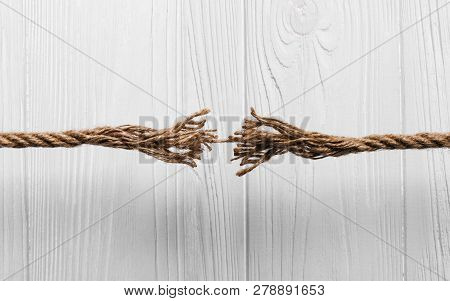 Rope Frayed About To Break On Wooden White Background